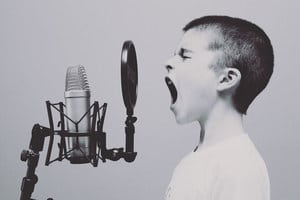 How To Make Your Affirmations Work Faster kid yelling into a mic