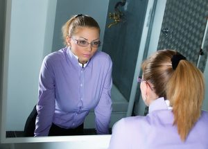 How To Make Your Affirmations Work Faster staring in mirror